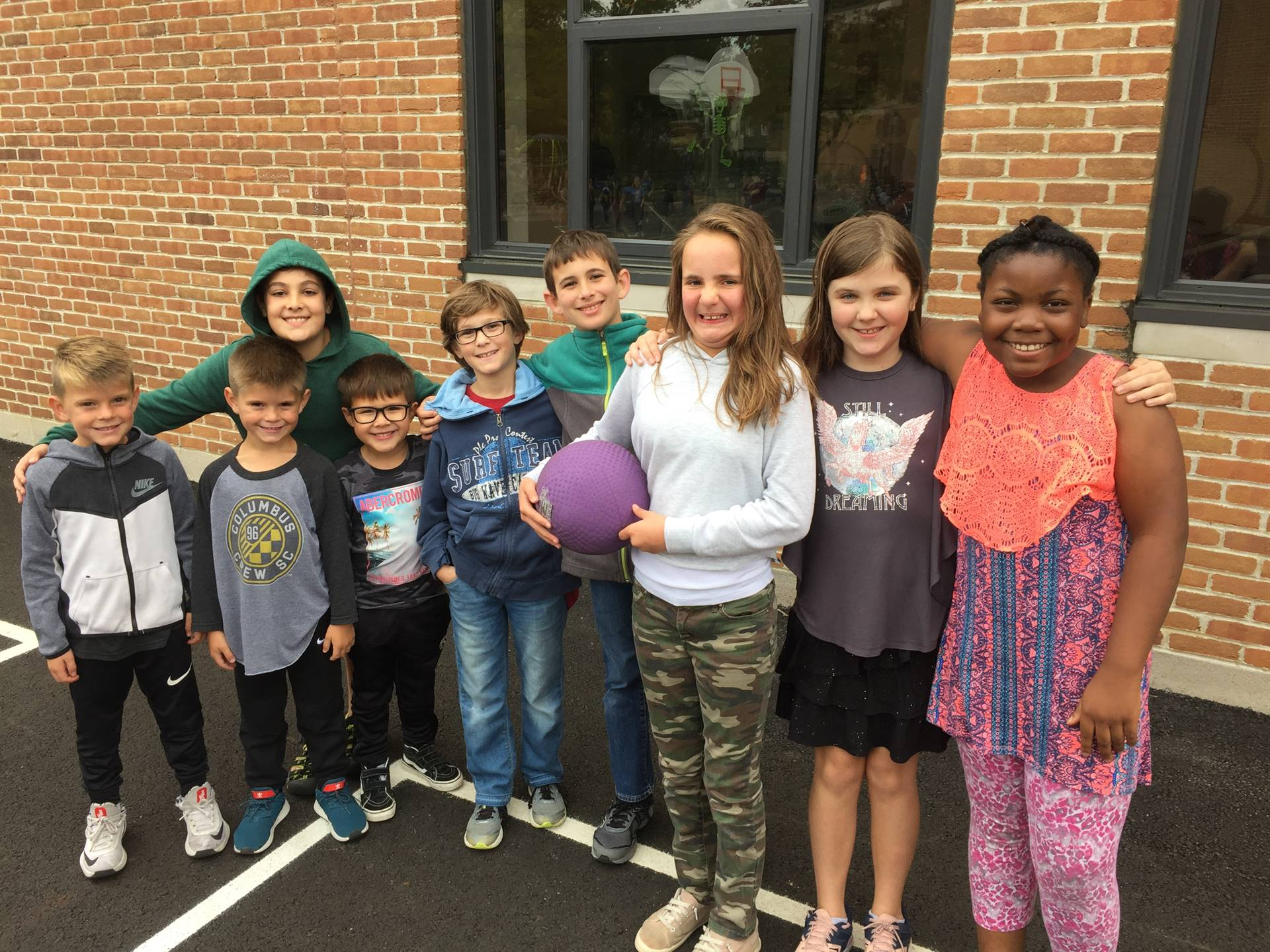 Kindergarten and 5th grade students play together