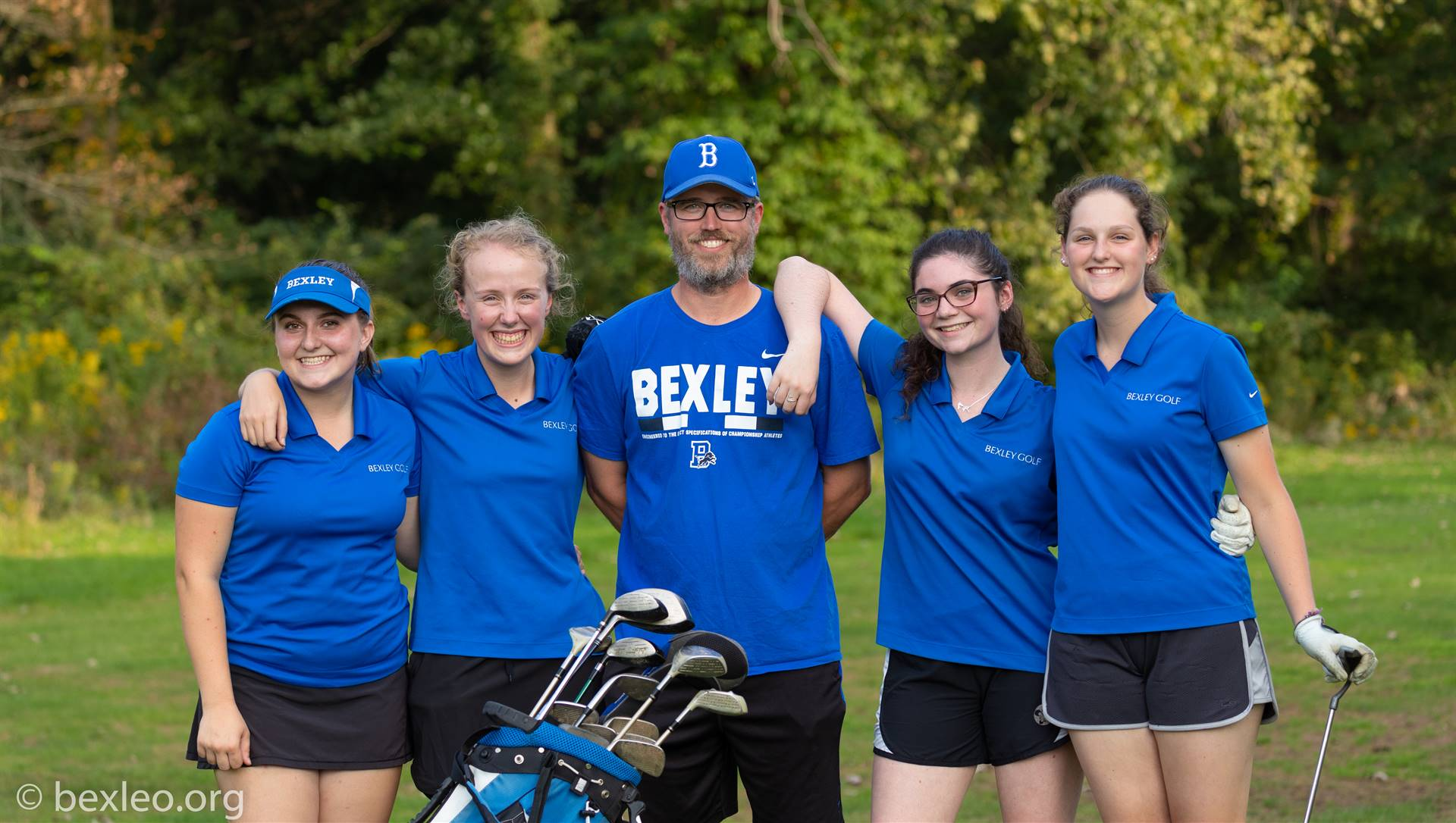 Varsity Girls Golf players and coach