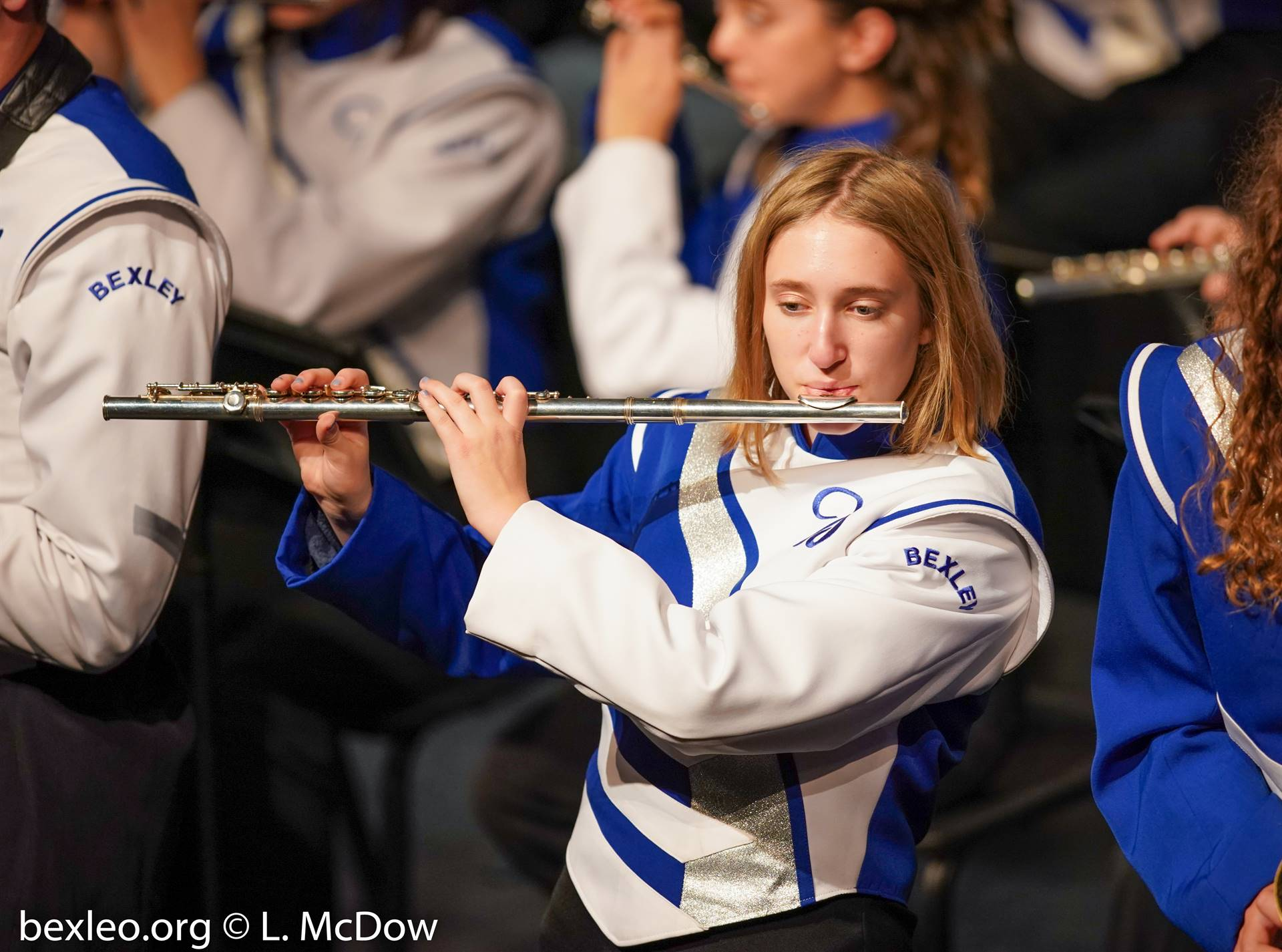 Marching Band Flute player performing on stage