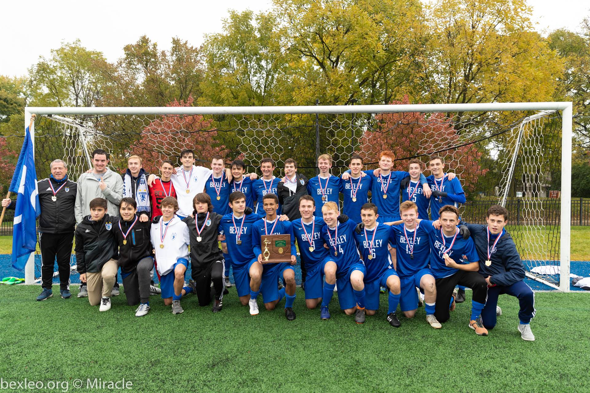 Boys Soccer team poses with District Title Trophy