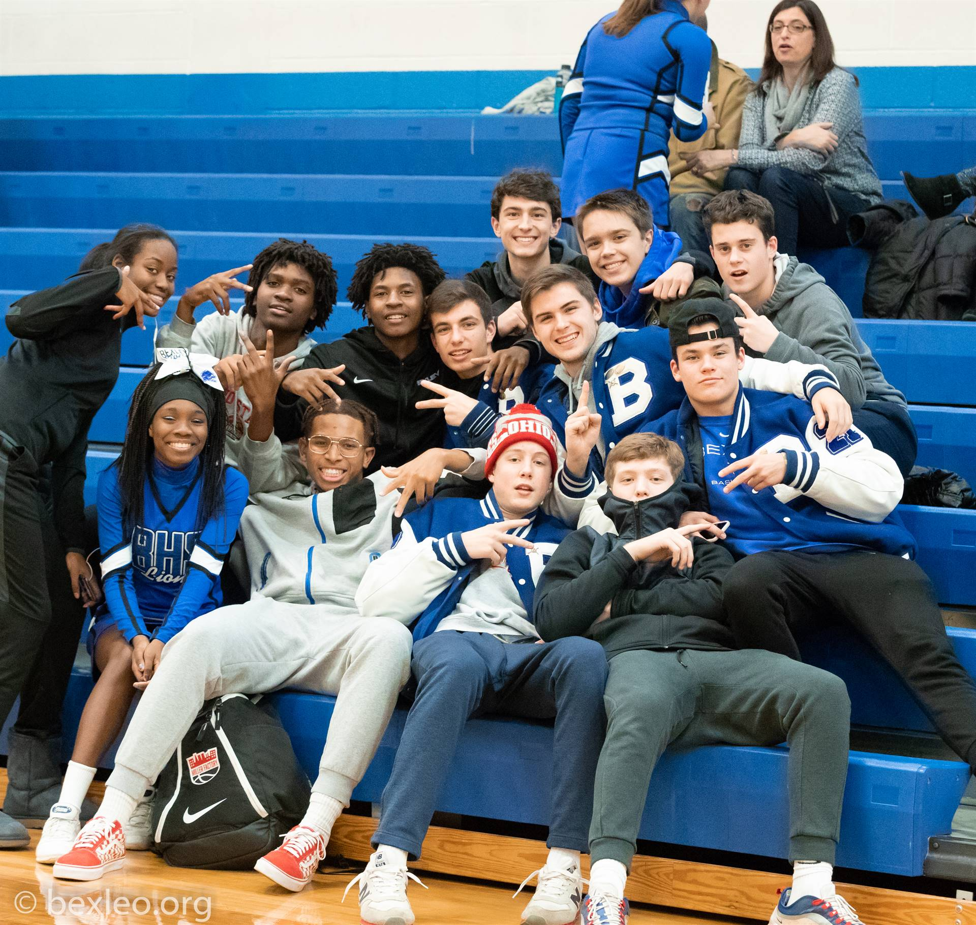 Fans cheering on the Girls Basketball team