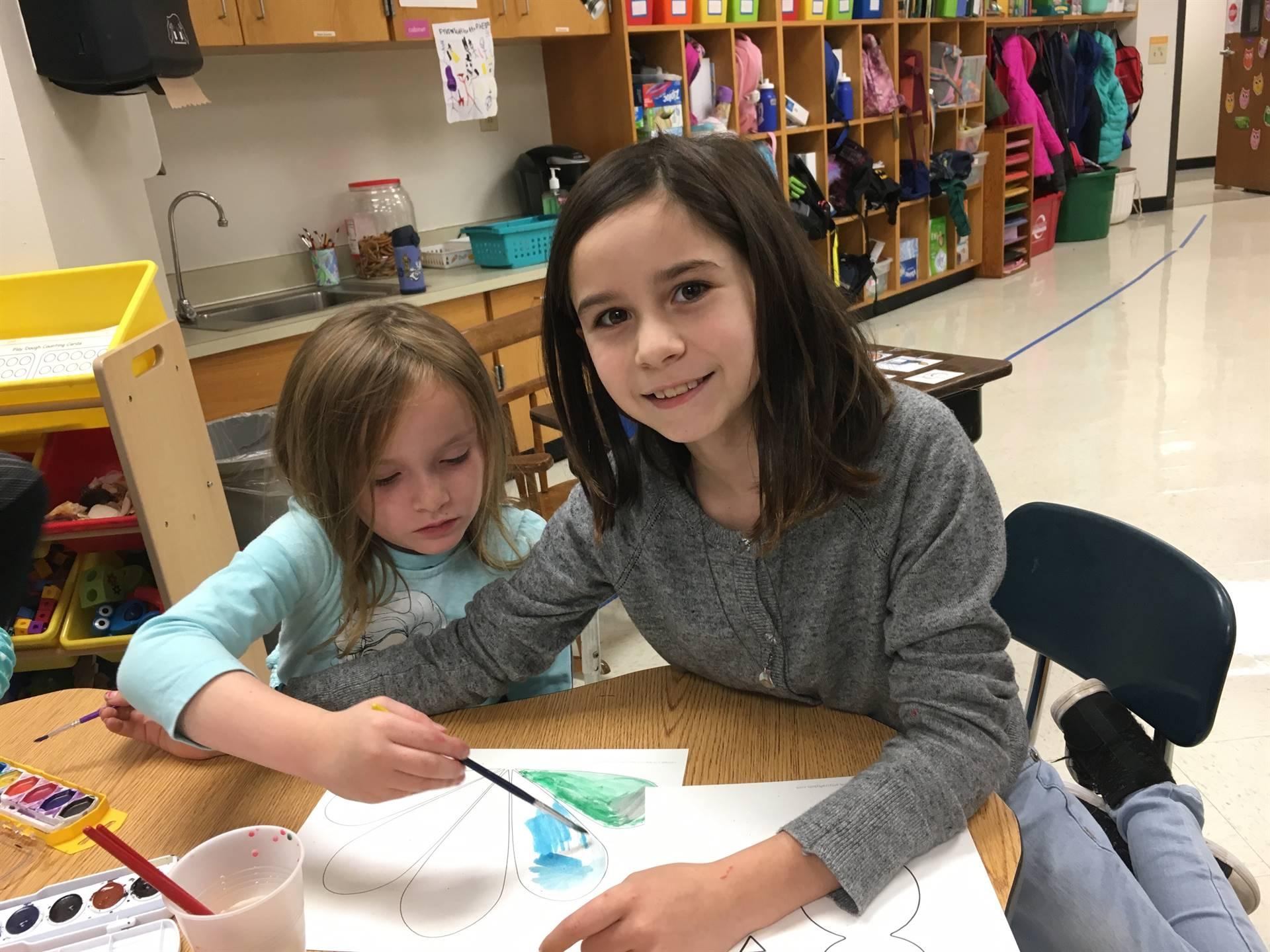 5th Grade and Kindergarten buddies working together.