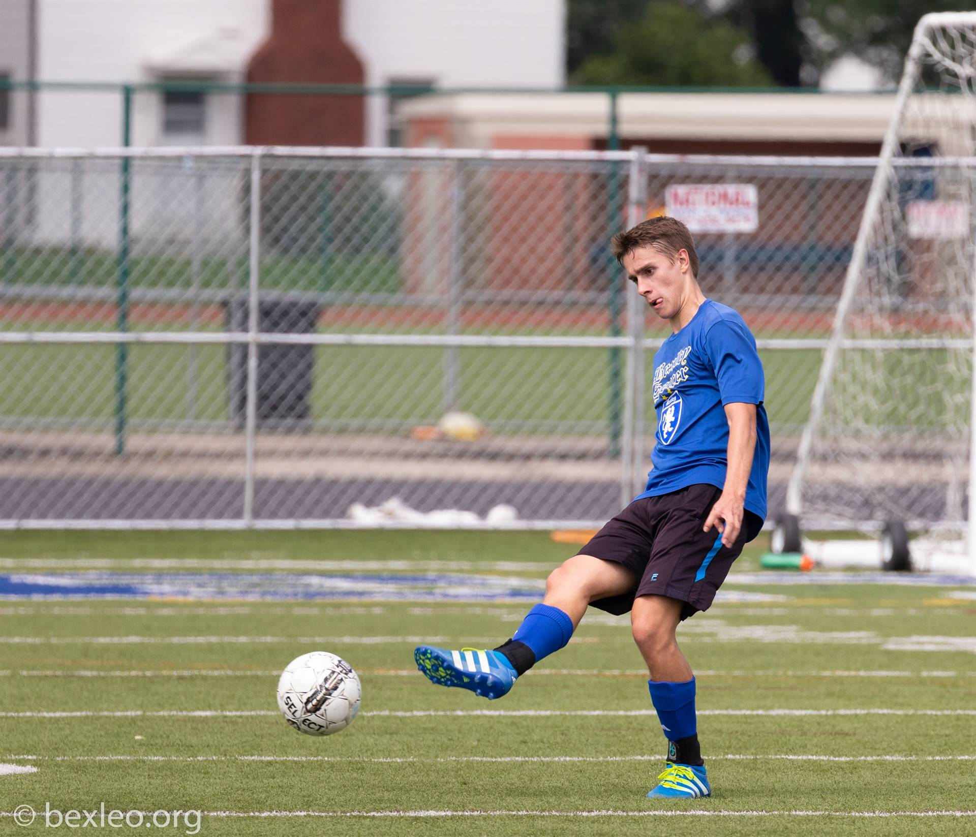 Varsity Soccer player Grant Halliday clears the ball