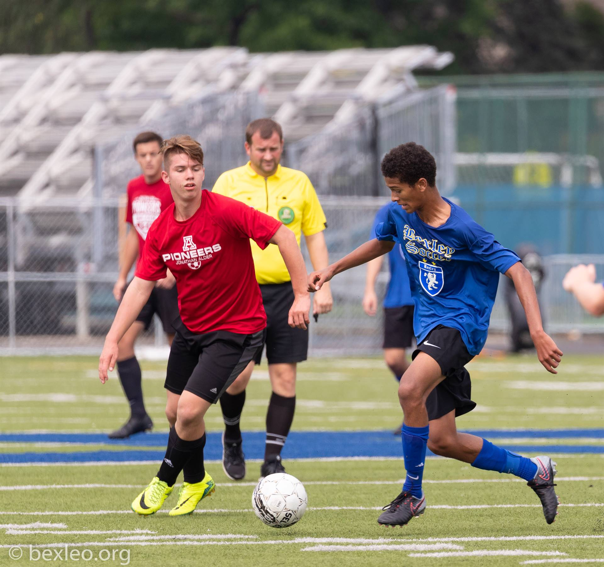 Soccer player Miles Joseph secures possession of the ball