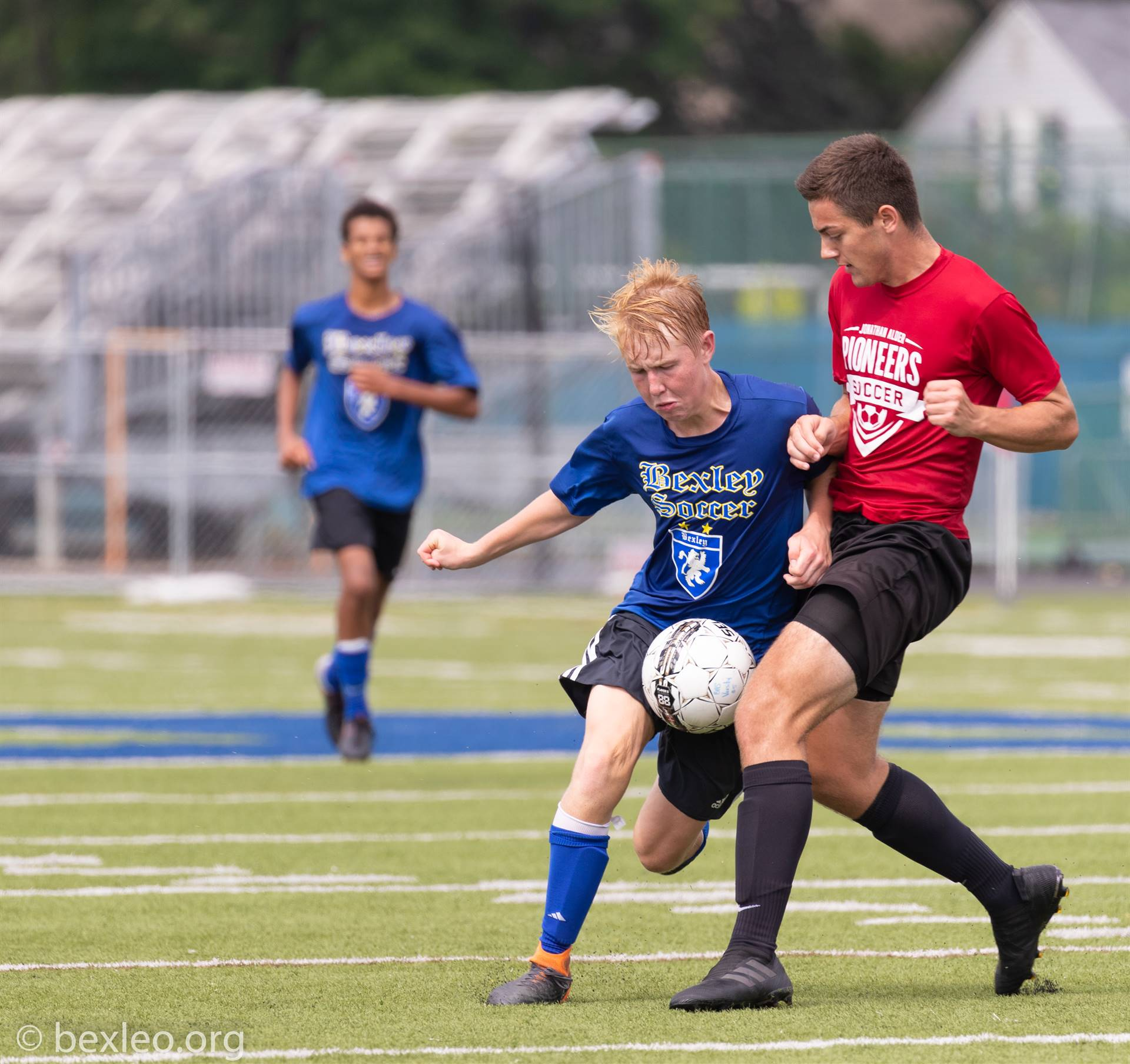 Soccer player Ford Cowan wins possession of the ball