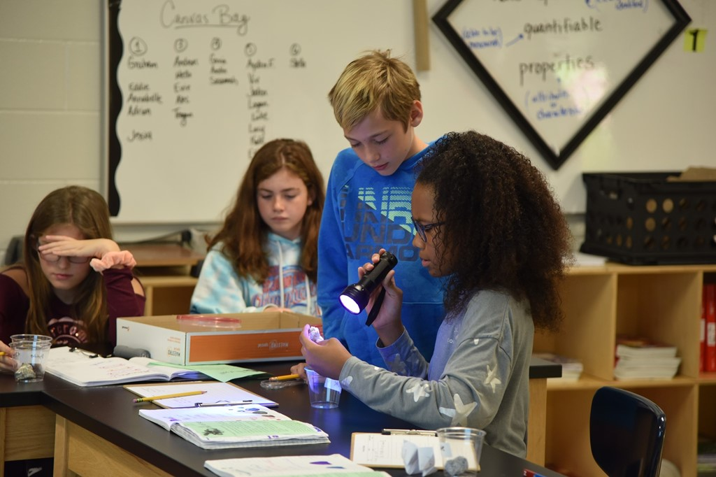 BMS students examining minerals