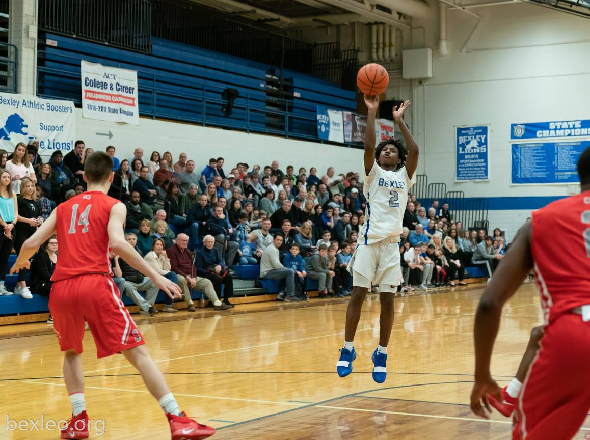 Nasir Tucker sinks a jumper in a victory over St. Charles at home