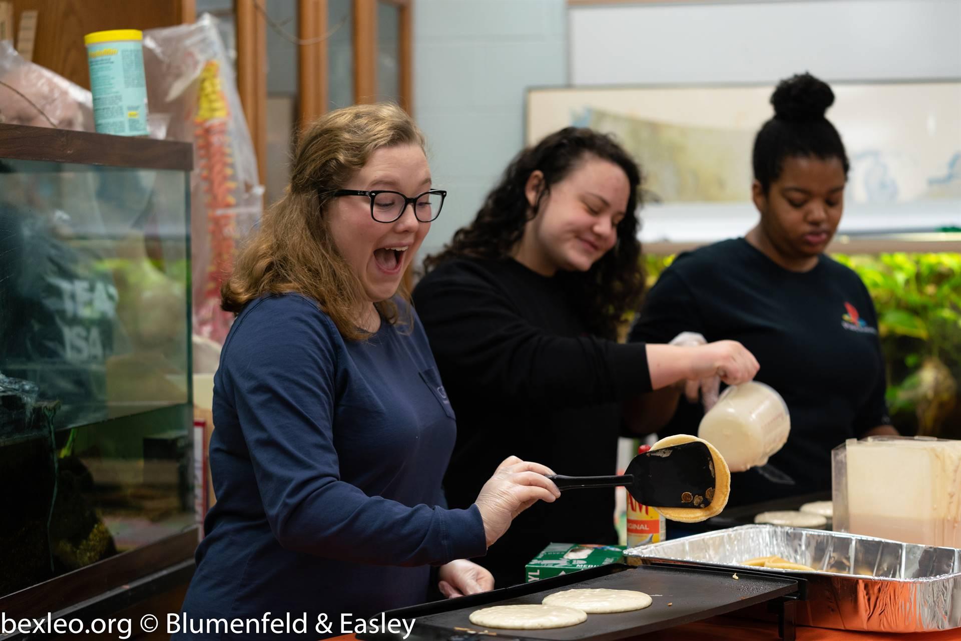 Environmental Club members Elizabeth White, Emma Beckman, and ReJenae Dockery prepare pancakes for t