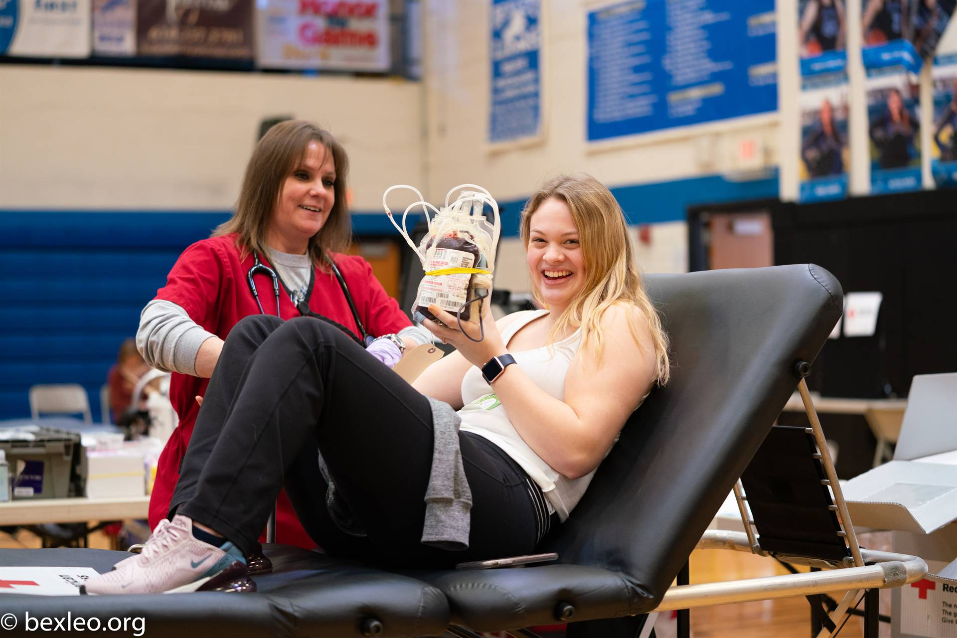 Laura Woodward donates blood to the American Red Cross as part of Environmental Club's blood dri