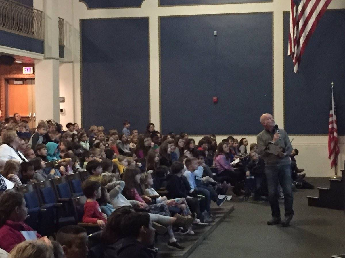 Michael J. Rosen reads aloud with the entire school.