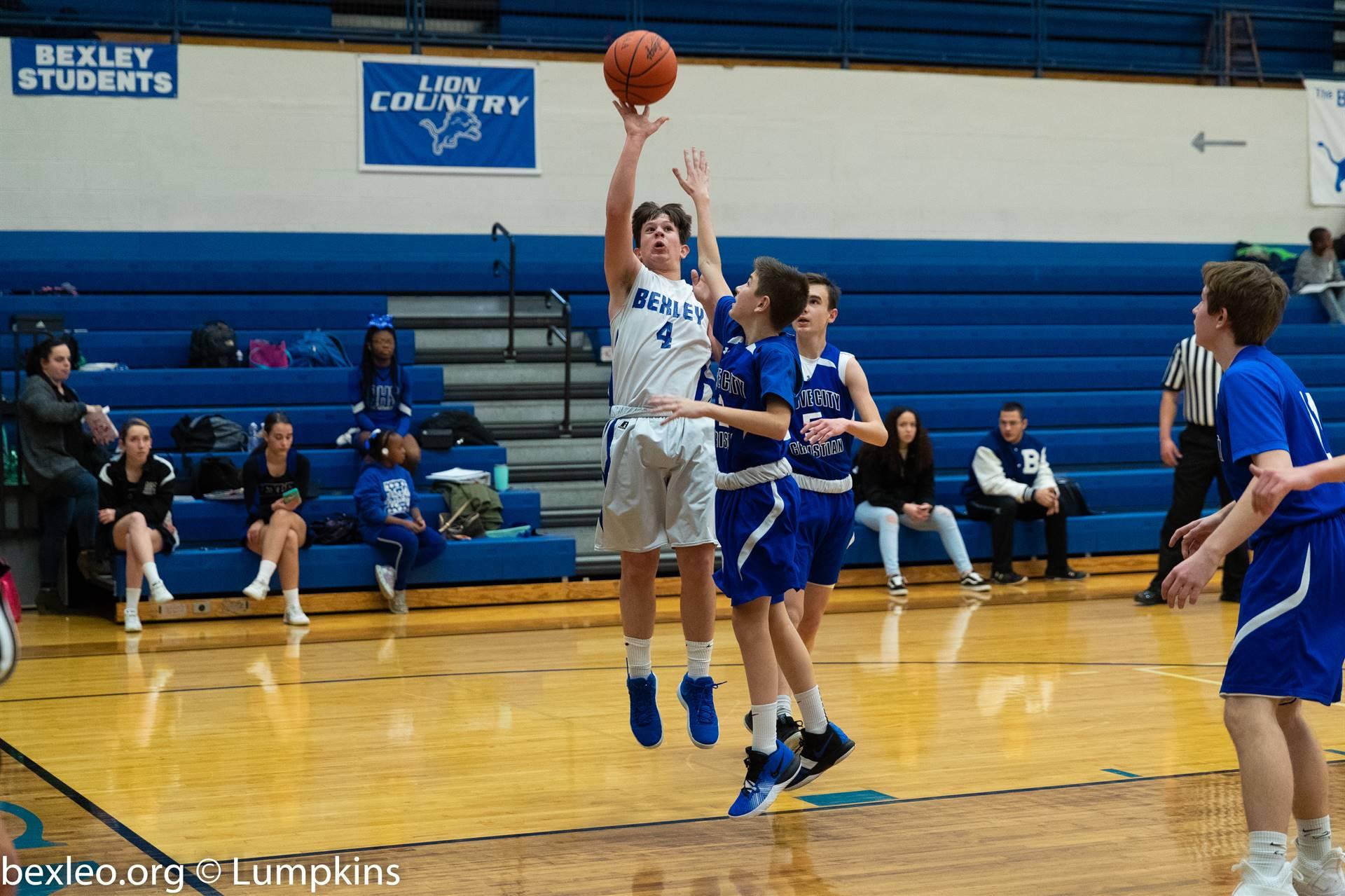 Freshman basketball player takes a jump shot