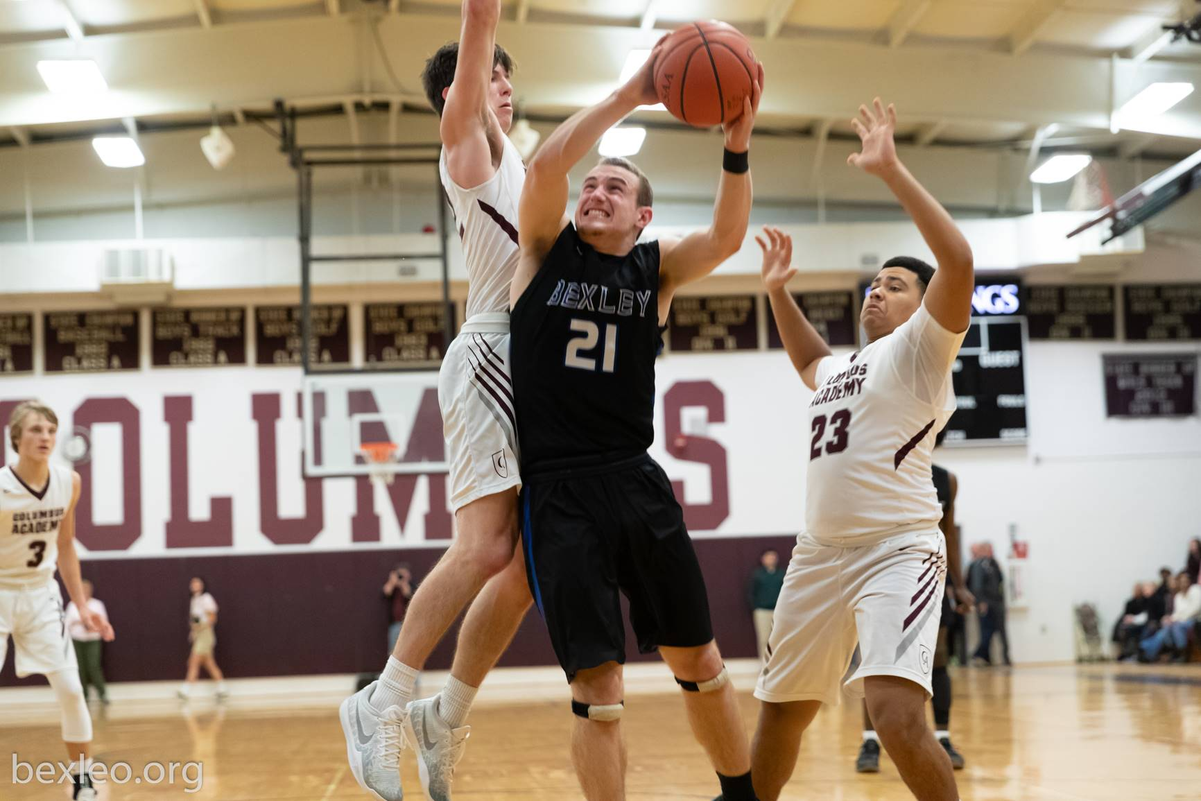 Basketball Player drives against Columbus Academy