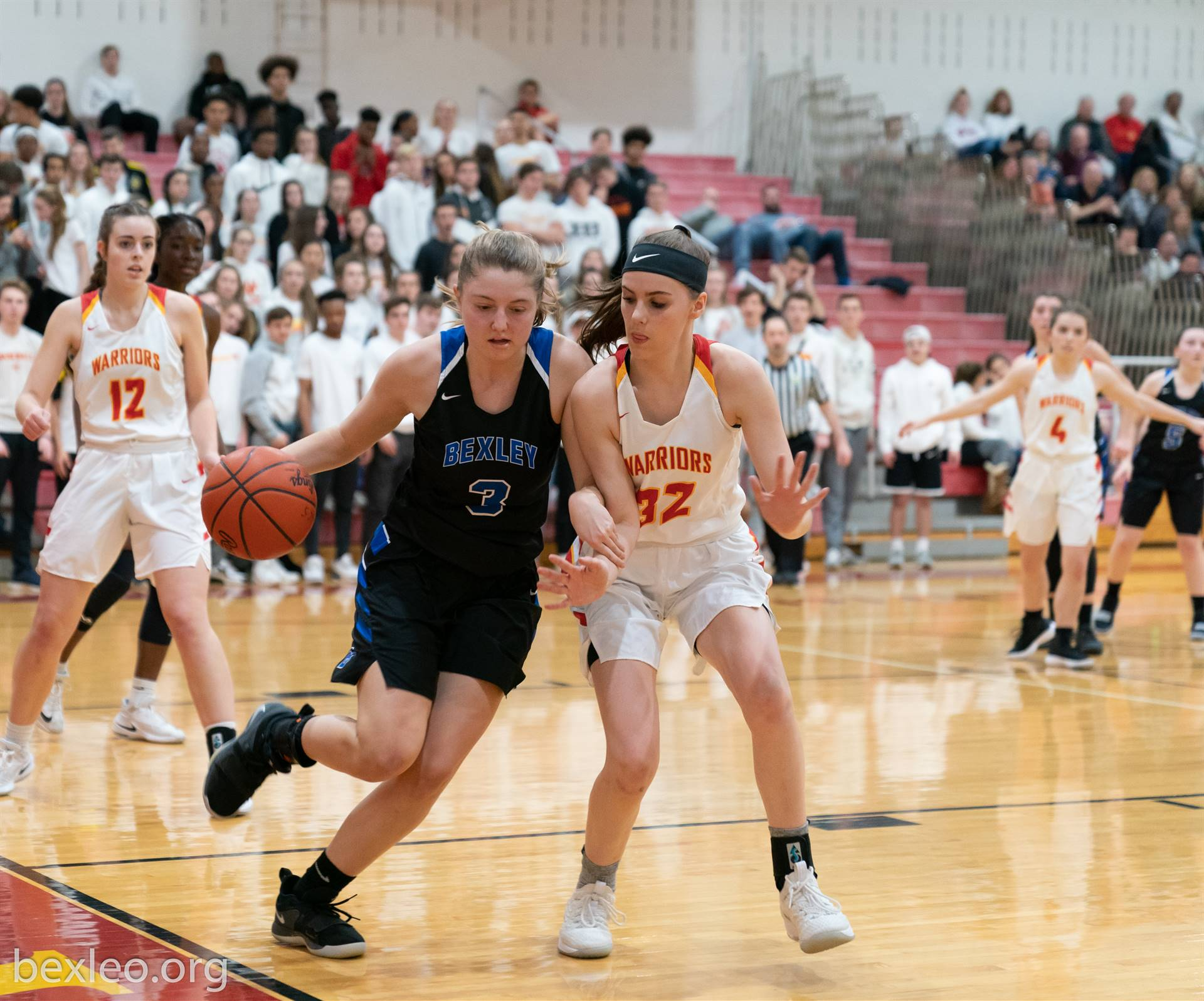 Girls Basketball Player drives baseline