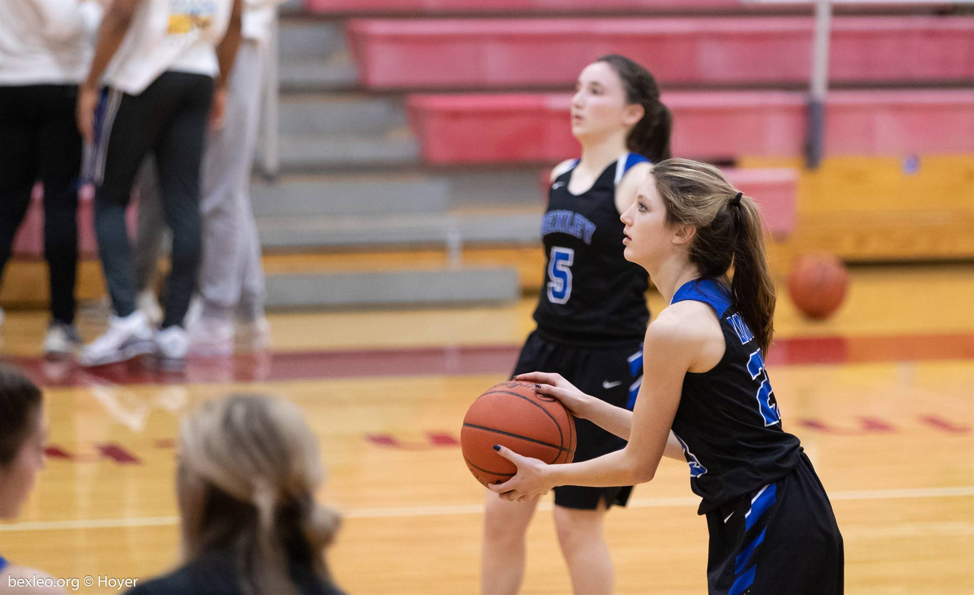 Girls Basketball Player prepares to launch a three-point shot