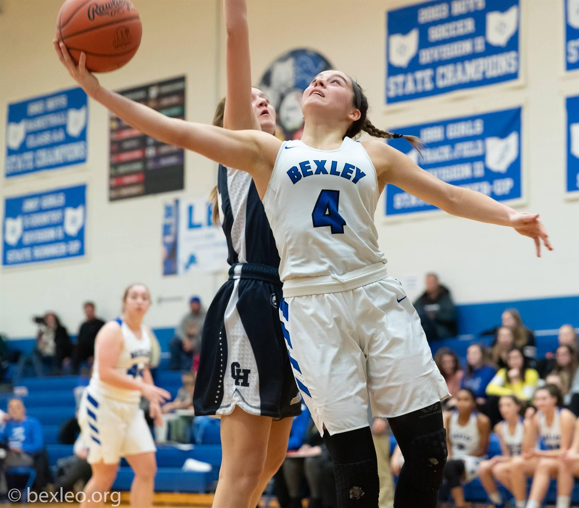 Girls Basketball Player drives baseline