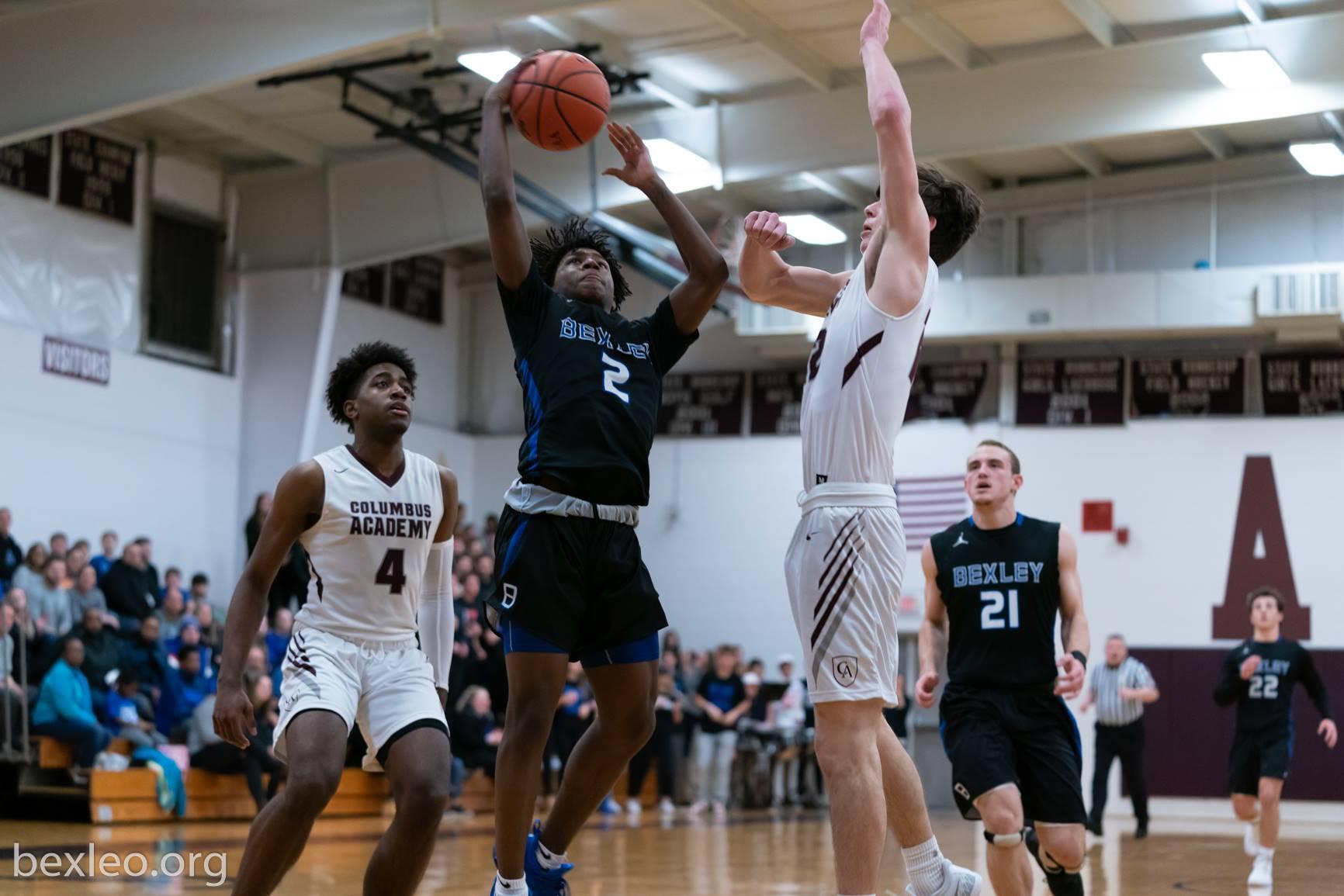 Boys Basketball player drives vs Columbus Academy