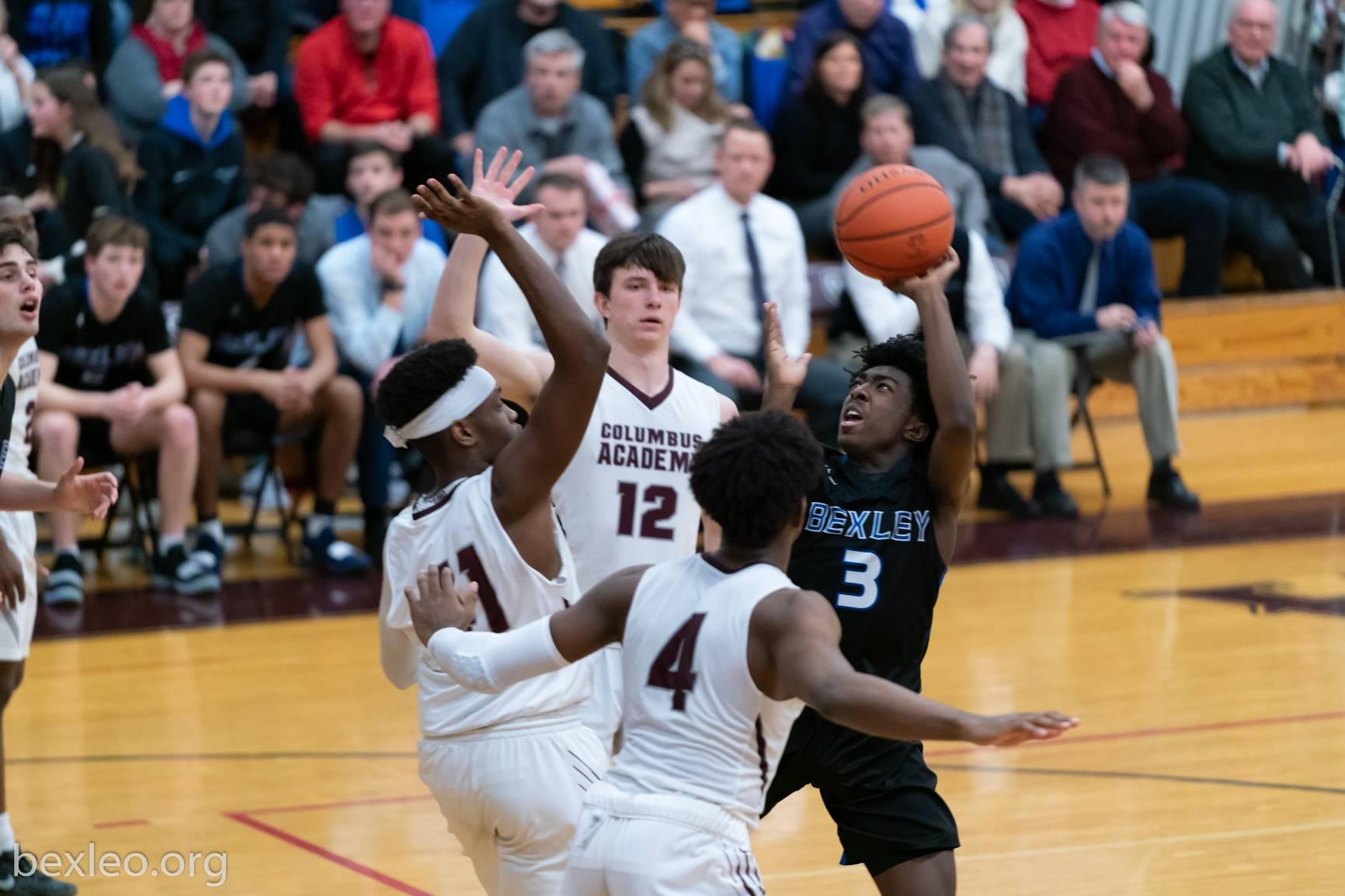Boys Basketball player shoots vs Columbus Academy