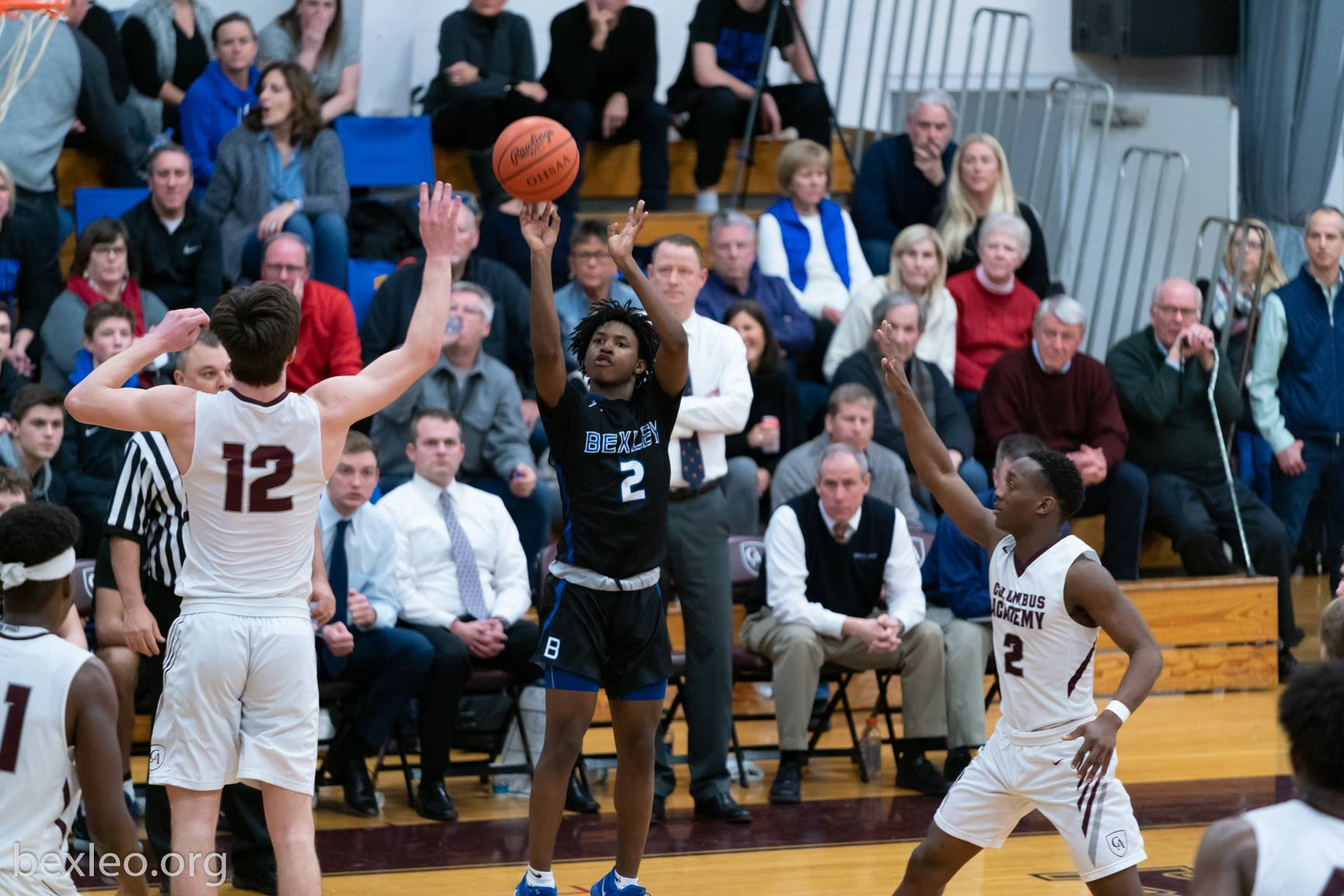 Boys Basketball player shoots a jumper vs Columbus Academy