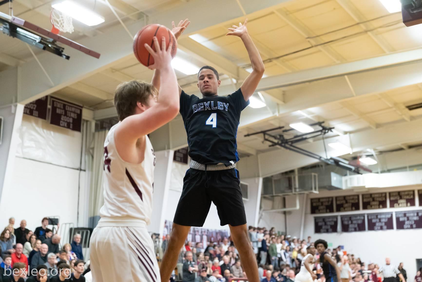 Boys Basketball Player guards the inbound pass vs Columbus Academy
