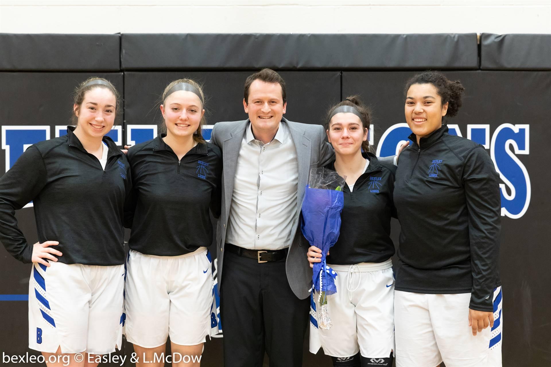 Bexley High School Senior Girls Basketball Players & coach pose for a photo