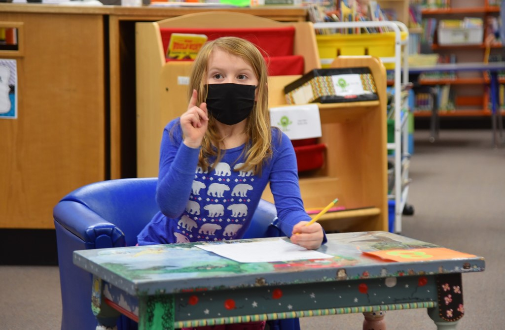 student pointing her finger